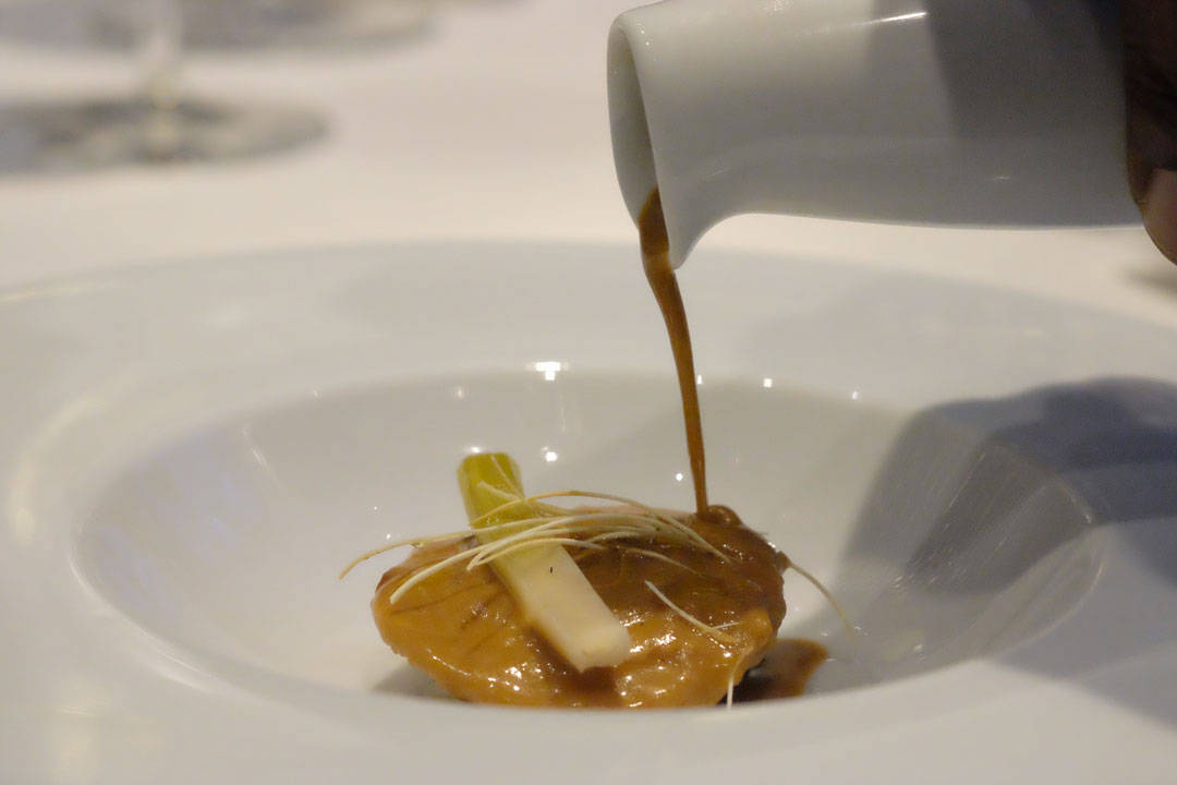 "Alaskan King Crab and Foie Gras Ravioli Stewed Leeks in Vinaigrette Lightly Creamed ""Lobster Jus – Soup"""